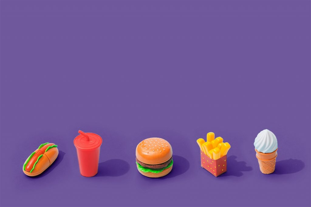 fast food icons on purple background